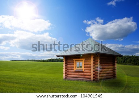 Beautiful day landscape with small house on meadow - stock photo