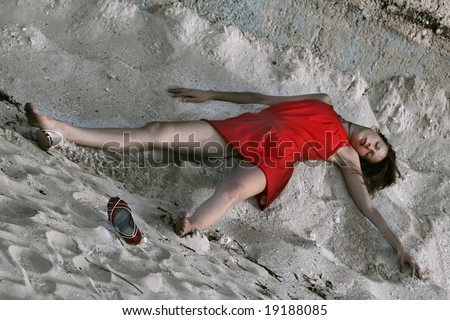 beautiful dead woman in the sand - stock photo