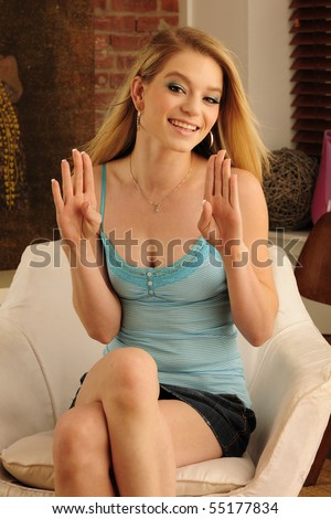 "Beautiful deaf model using American Sign Language to sign the letter ""B"" with her hands. - stock photo"