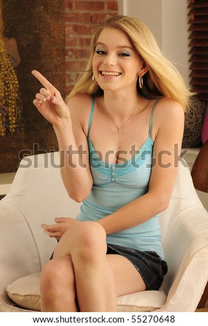 "Beautiful deaf model using American Sign Language to sign the letter ""D"" with her hands. - stock photo"