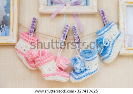 beautiful decor for a newborn on wall, baby shoes - stock photo