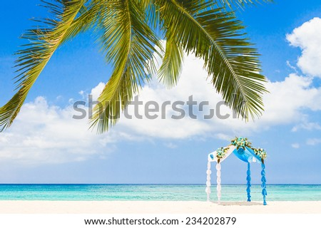 beautiful decorated arch, gazebo, cabana, beach wedding - stock photo