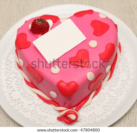 Beautiful decorated cake, heart shape, with strawberry - stock photo