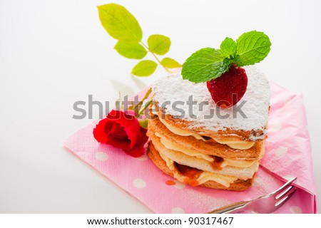 Beautiful decorated cake, heart with strawberry - stock photo