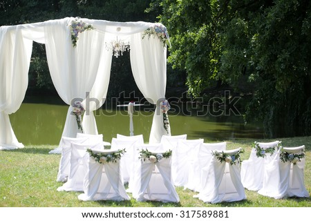 Beautiful Decorated With Light White Chiffon Chandelier And Bouquets Of Roses Pastel Colors Wedding Pavilion Chairs