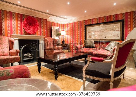 Beautiful decoration room, classical library in London with a fireplace and furniture. Luxury in rich style. - stock photo