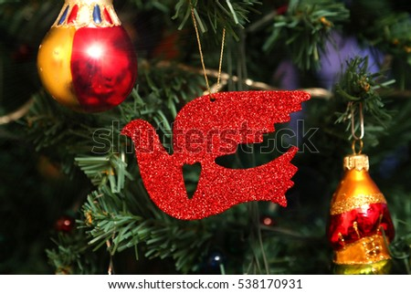 beautiful decorations and red bird close up on faux christmas tree - Red Bird Christmas Tree Decorations