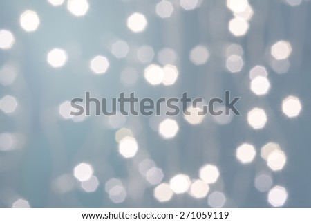 Beautiful defocused LED lights filtered bokeh abstract with light-green tone background. - stock photo
