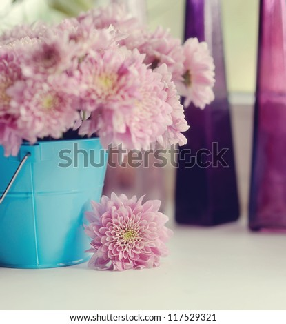 beautiful delicate bouquet of pink chrysanthemums in a blue bucket - stock photo