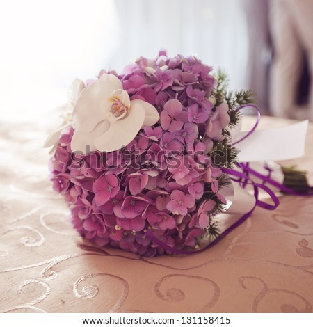 beautiful delicate bridal bouquet on the table. floral wedding theme. - stock photo