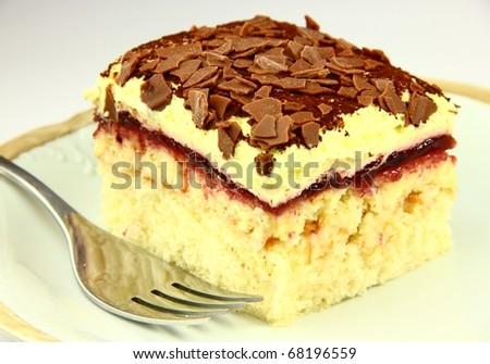 Beautiful delicious cake on white background - stock photo