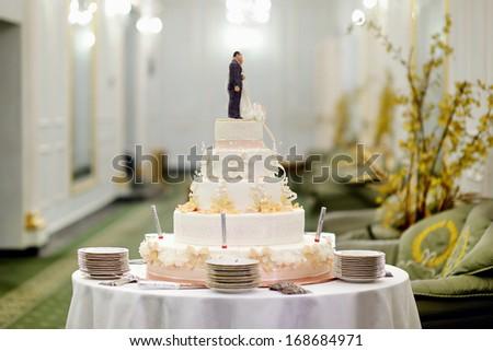 Beautiful delicious white wedding cake - stock photo