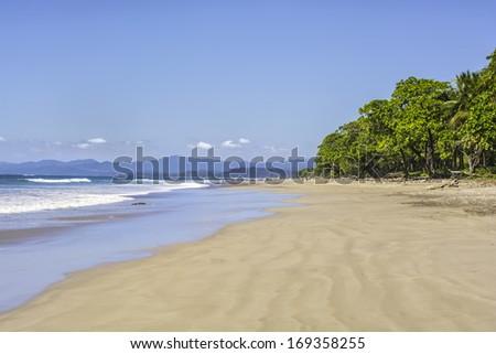 Beautiful deserted beach at Playa Manzanillo in Costa Rica - stock photo