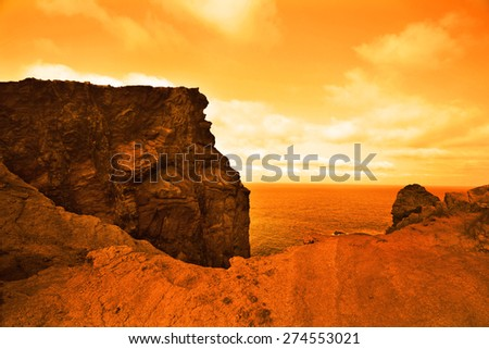 beautiful deserted planet with vast ocean in orange colors - stock photo