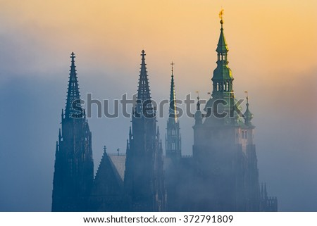Beautiful detailed view of Prague Castle towers during sunrise - stock photo