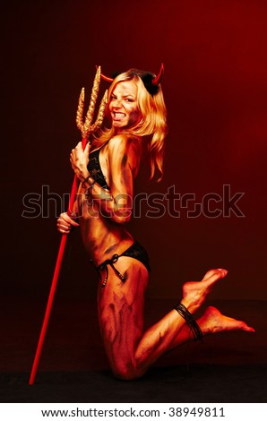 Beautiful devil with trident, Halloween - stock photo