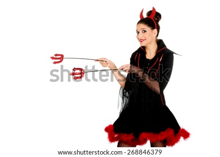 Beautiful devil woman pointing aside with trident. - stock photo