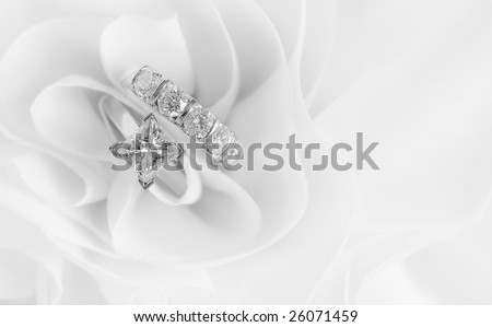 Beautiful Diamond Wedding Rings on white background with space for copy. - stock photo