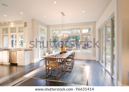 Beautiful Dining Room in New Luxury Home - stock photo