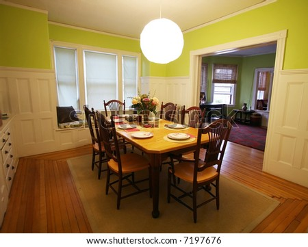 beautiful dining room with table set for dinner - stock photo
