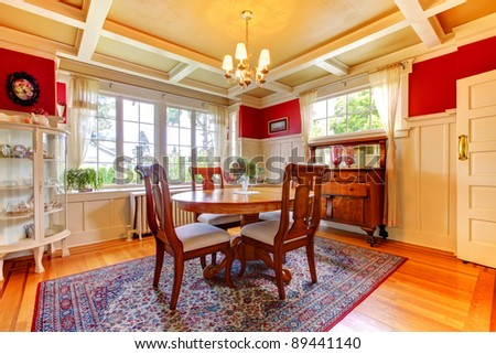 Beautiful dining room with wood floor and large windows.