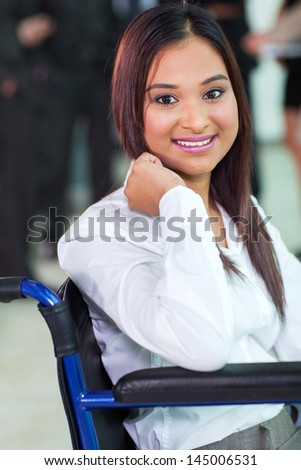 beautiful disabled office worker in a wheelchair - stock photo