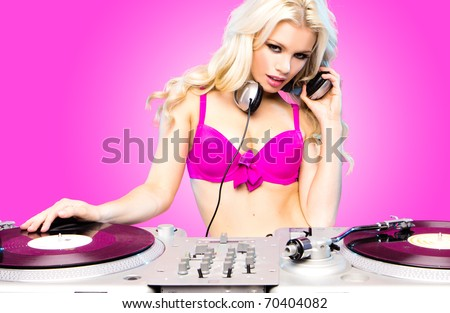 Beautiful DJ girl on decks on the party,blonde model wearing pink bra , candy girl - stock photo
