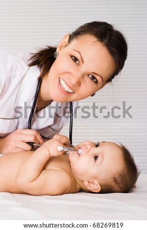 beautiful doctor and baby on a white background - stock photo