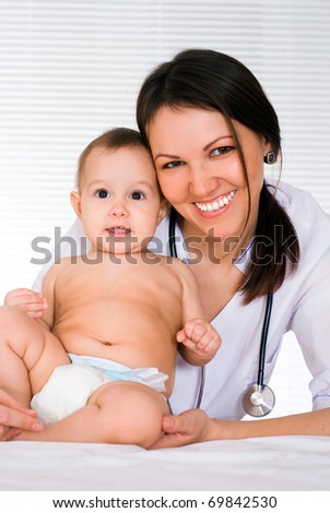 beautiful doctor and newborn on a white background - stock photo