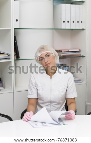 Beautiful doctor or nurse in office - stock photo