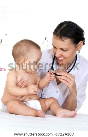 beautiful doctor with newborn on a white background - stock photo