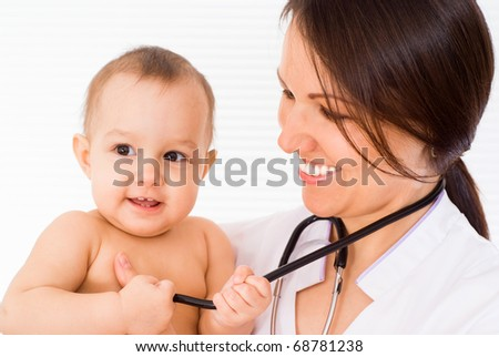 beautiful doctor with newborn on a white background