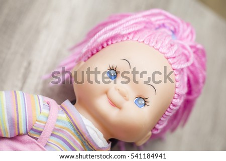 Beautiful doll on a neutral background