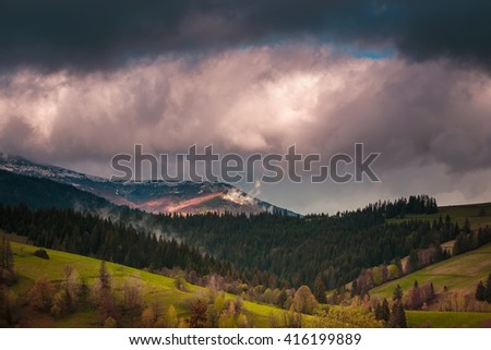 Beautiful dramatic clouds over green mountains. Carpathian mountains. Ukraine.