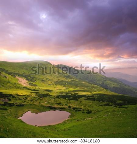Beautiful dramatic sky and sundown Carpathian mountains - stock photo