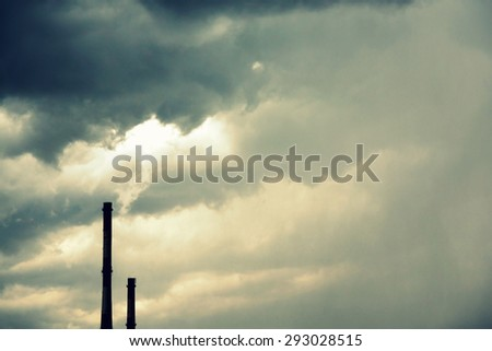 Beautiful dramatic sky over pipe of power plant