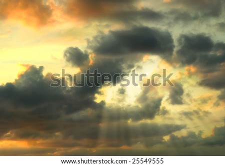 Beautiful dramatic sky with sun rays - stock photo