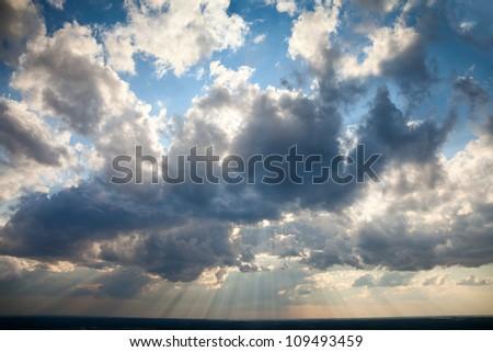 Beautiful dramatic sky with sun rays. Blue Heavens Idyllic Wallpaper Broad Daylight. - stock photo