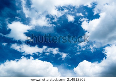 Beautiful dramatic sky with sun rays during a bright summer day - stock photo