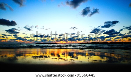 Beautiful dramatic sunset on Mediterranean sea - stock photo