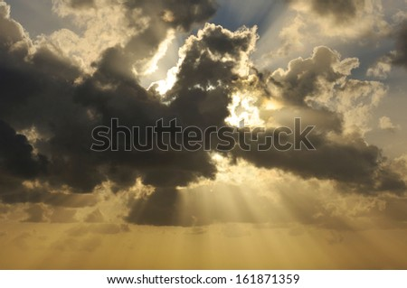 Beautiful dramatic sunset sky with sun rays. Wallpaper or Background perfect image - stock photo