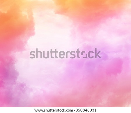Beautiful dreamy sky with pink and caramel clouds