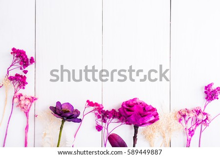 Beautiful dry purple pink flowers on stock photo royalty free beautiful dry purple pink flowers on white wood table background mightylinksfo