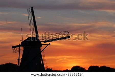 Beautiful dutch windmill at sunset - stock photo