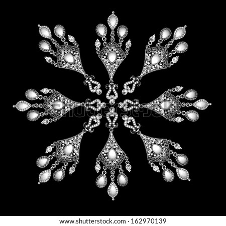 Beautiful earrings set in a circular pattern on a black background  - stock photo