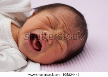 Beautiful East Asian Infant Girl Crying Loudly - stock photo