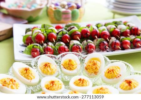 beautiful Easter appetizer food table for snacks before the big Easter dinner - stock photo
