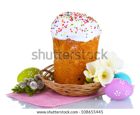 beautiful easter cake in basket colorful eggs and flowers isolated on