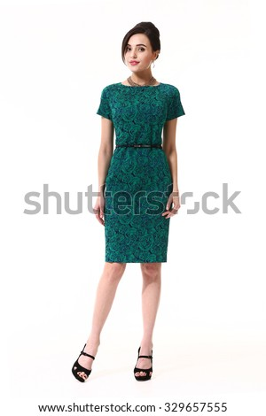 beautiful eastern woman in emerald party short sleeve dress isolated on white