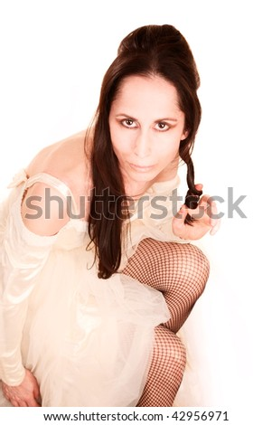 Beautiful eccentric adult woman in wedding dress and stockings - stock photo